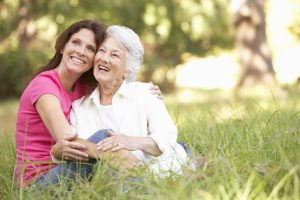 Medicare Insurance senior woman with adult daughter in park